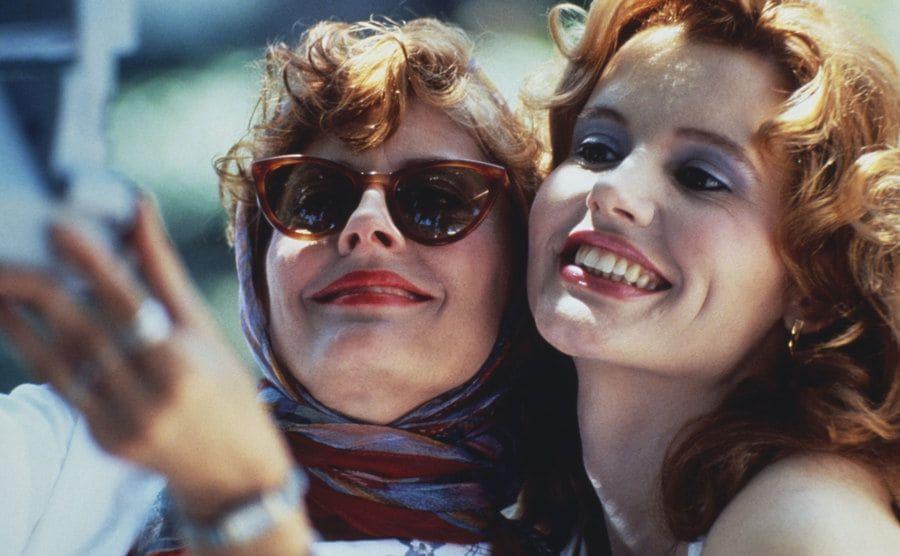 Susan Sarandon and Geena Davis taking a photograph