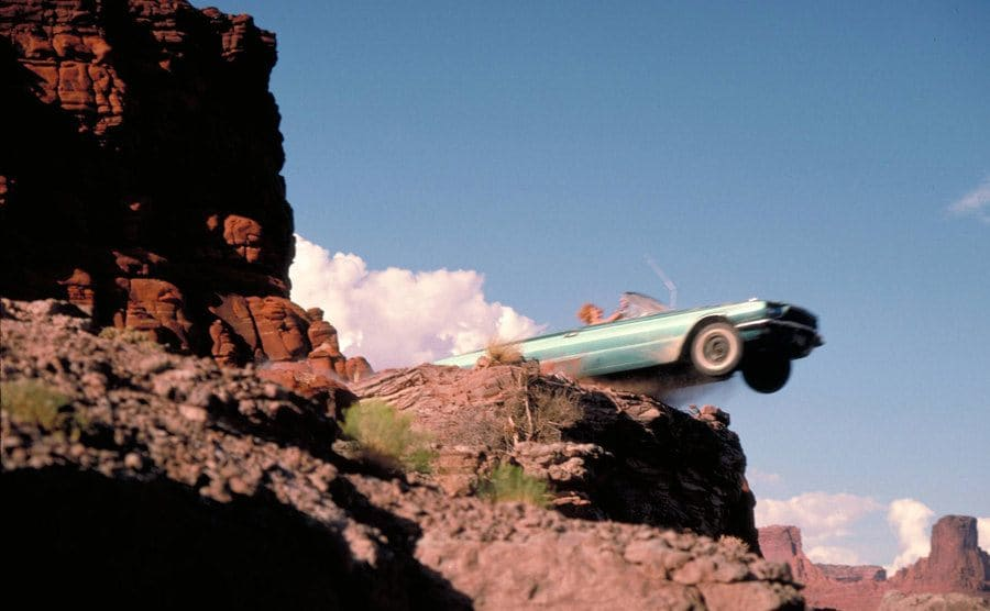 The car flying off of the cliff