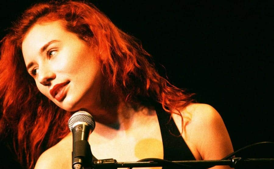 Tori Amos performing in front of a microphone