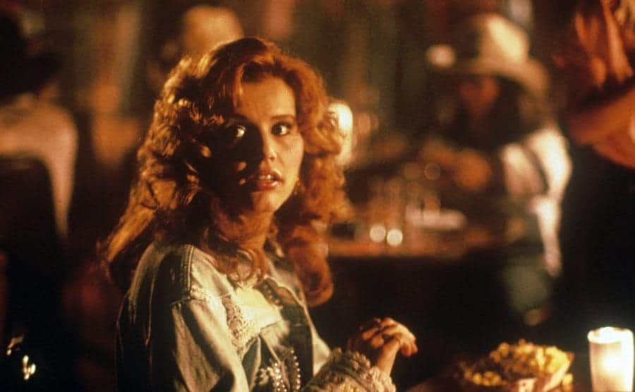 Geena Davis sitting in a restaurant in a scene from Thelma and Louise