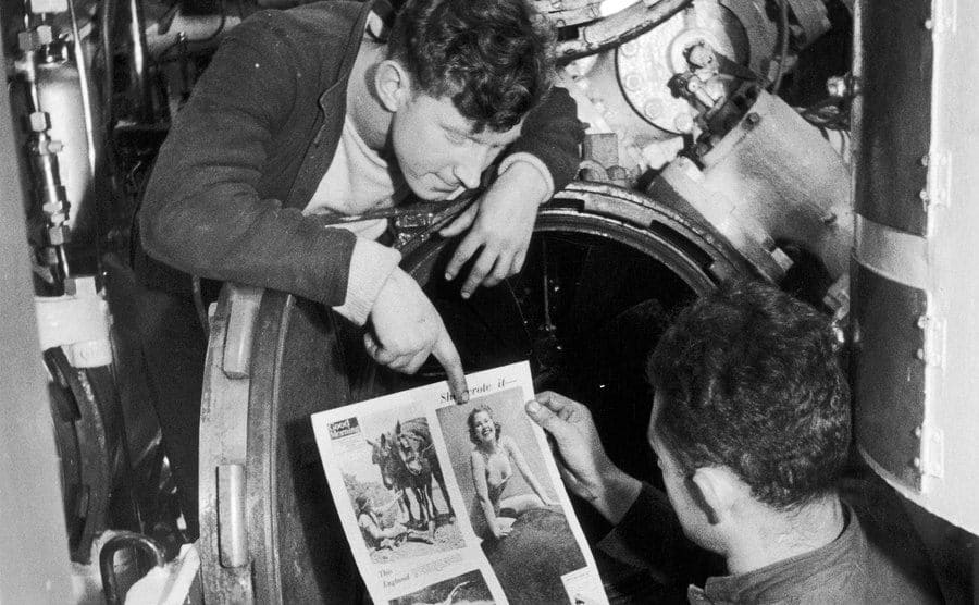 Submariners, pictured reading the Daily Mirror's Good Morning Newspaper noticing the photo of the woman.
