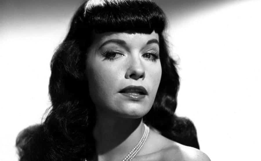 Pin-up model Bettie Page poses for a portrait.