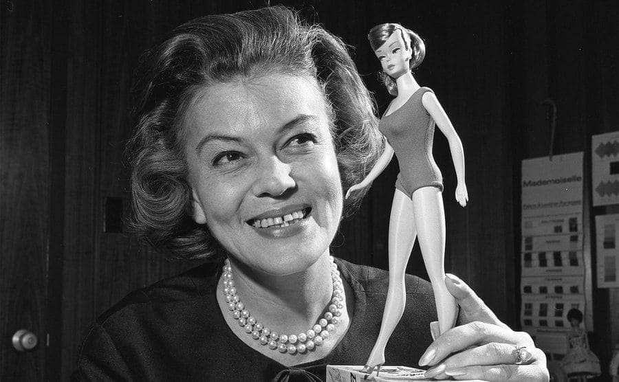 Charlotte Johnson, director of fashion for the highly successful Barbie doll, shows off one of their dolls.