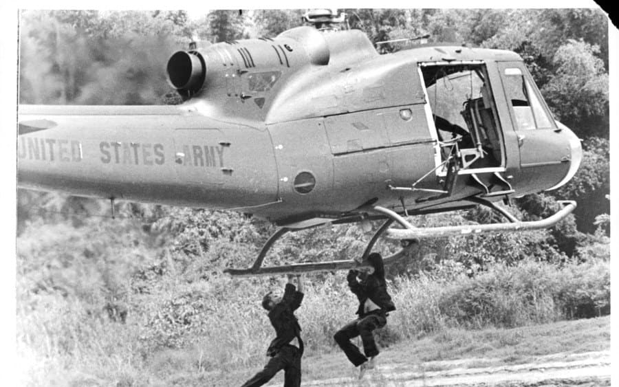 Copter lifting men in a scene from the film 'The Deer Hunter',