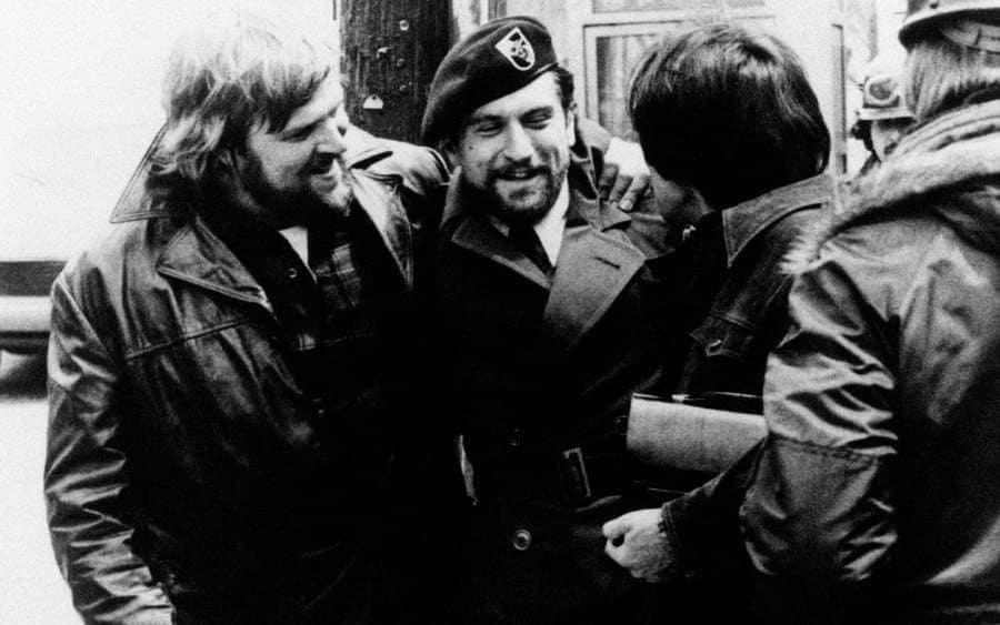 Robert De Niro, in military uniform, being celebrated by Chuck Aspegren
