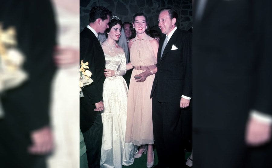 Elizabeth Taylor and Nicky Hilton speaking to guests during their wedding