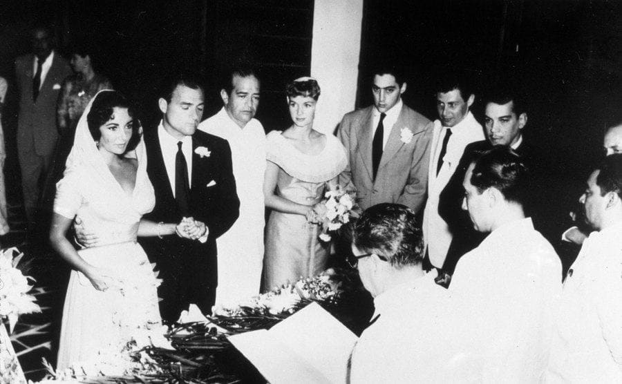 The wedding of Elizabeth Taylor and Mike Todd with all of their friends surrounding them