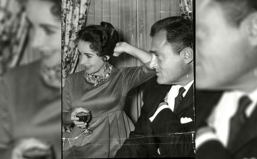 Elizabeth Taylor and Mike Todd at a party in April 1957