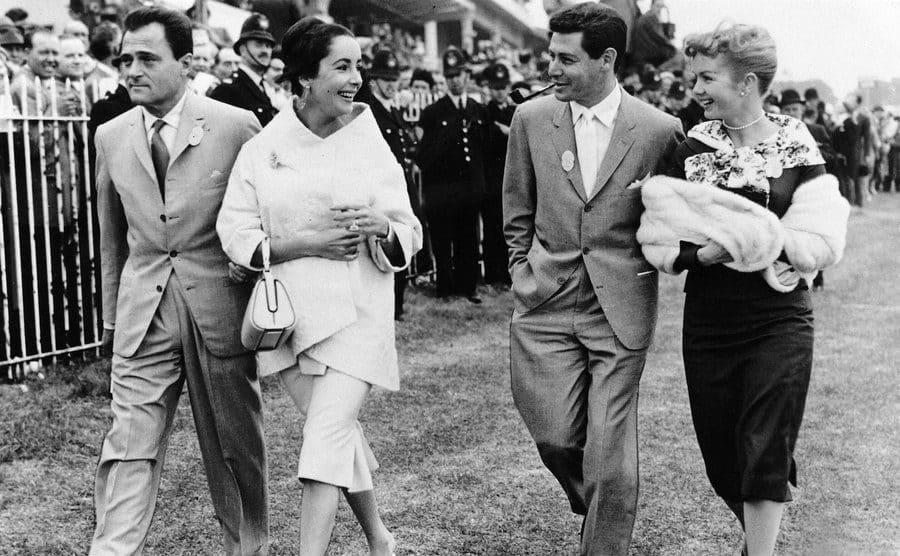 Elizabeth Taylor, Mike Todd, Eddie Fisher, and Debbie Reynolds walking together