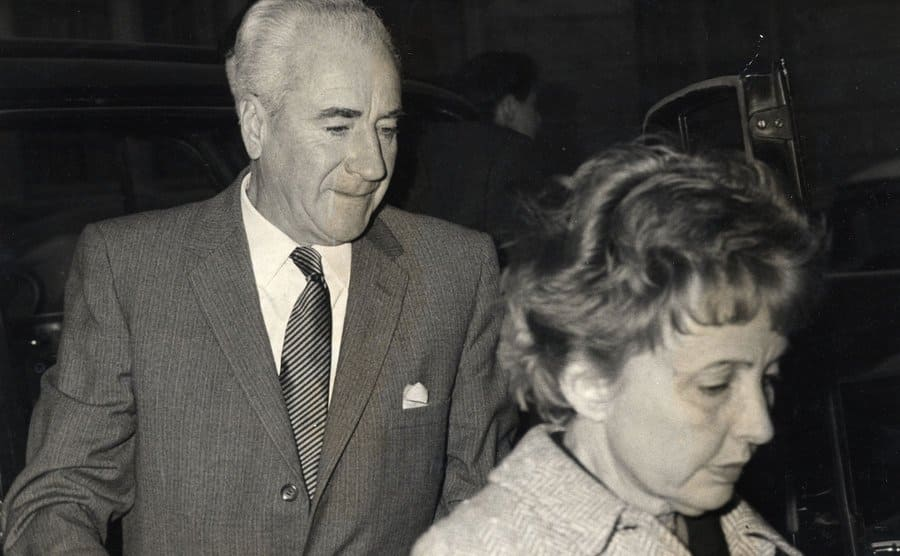 Sara and Francis Taylor, parents of Elizabeth Taylor, leaving the hospital where Elizabeth was suffering from a pneumonia