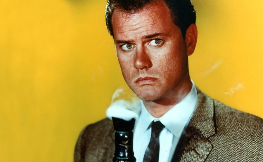Larry Hagman holds the Jeannie bottle in a publicity portrait.