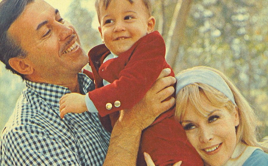 Michael Ansara and Barbara Eden are posing with their young boy.