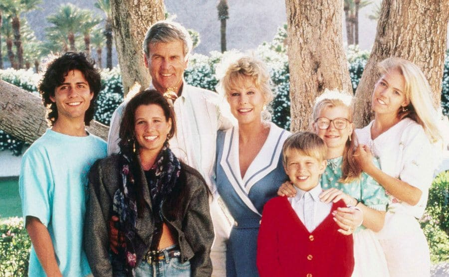 The cast members pose for a promo shot.