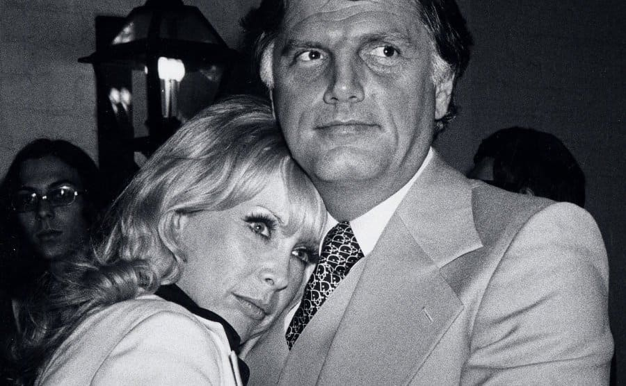 The press spots Charles Fegert embracing Barbara Eden.
