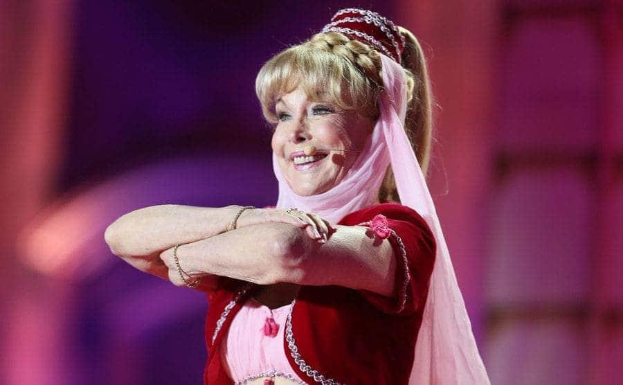 Barbara Eden performs onstage wearing her Jeannie costume.