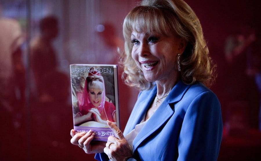 Barbara Eden poses, holding her book ''Jeannie Out Of The Bottle.''