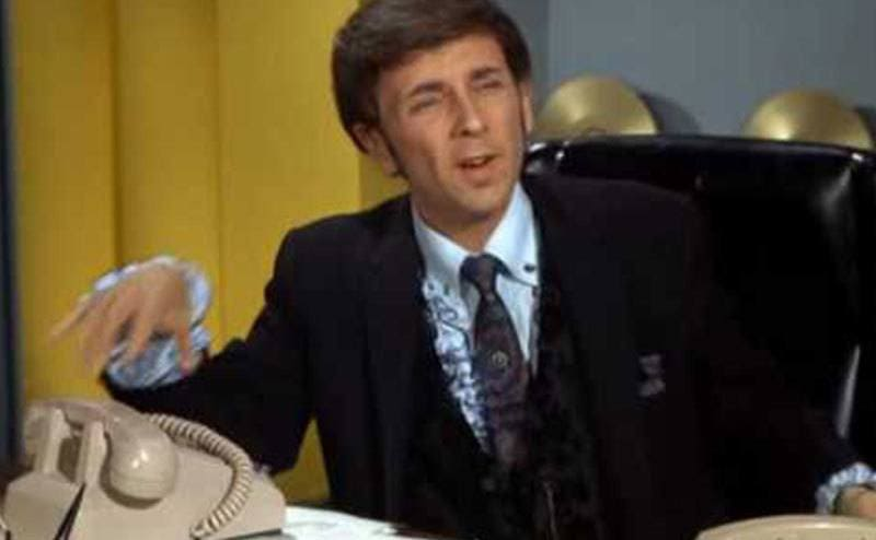 An episode still featuring Phil Spector talking on the phone.