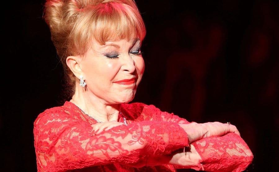 Barbara Eden makes her signature move onstage.