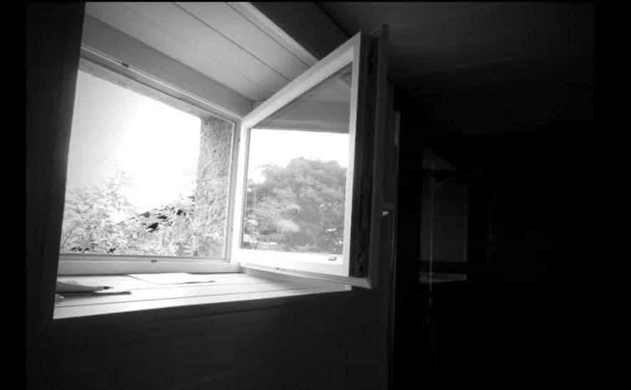 An open window in a dark room.
