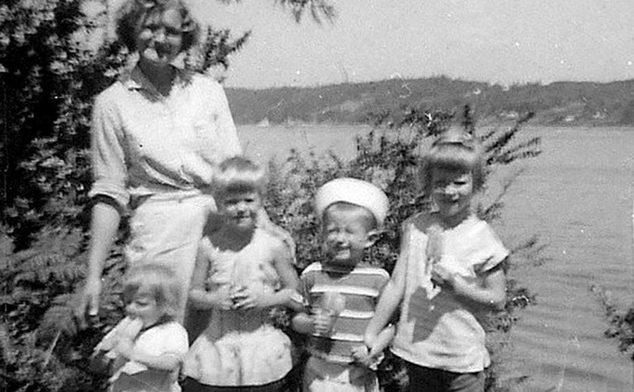 Ann Marie with her siblings and mother by the lake.