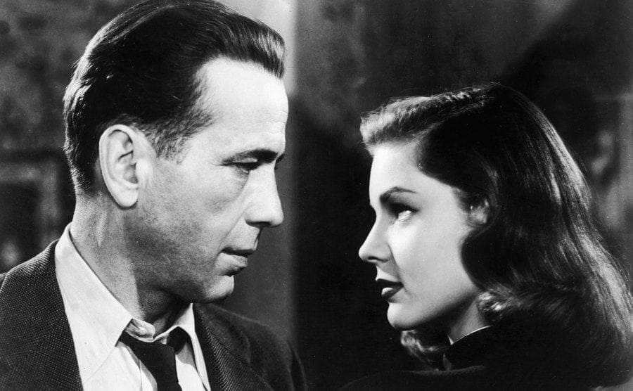 Humphrey Bogart and Lauren Bacall look into each other's eyes.