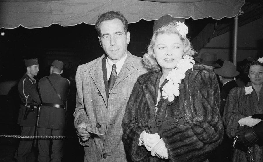 Humphrey Bogart and Mayo Methot attend an event.