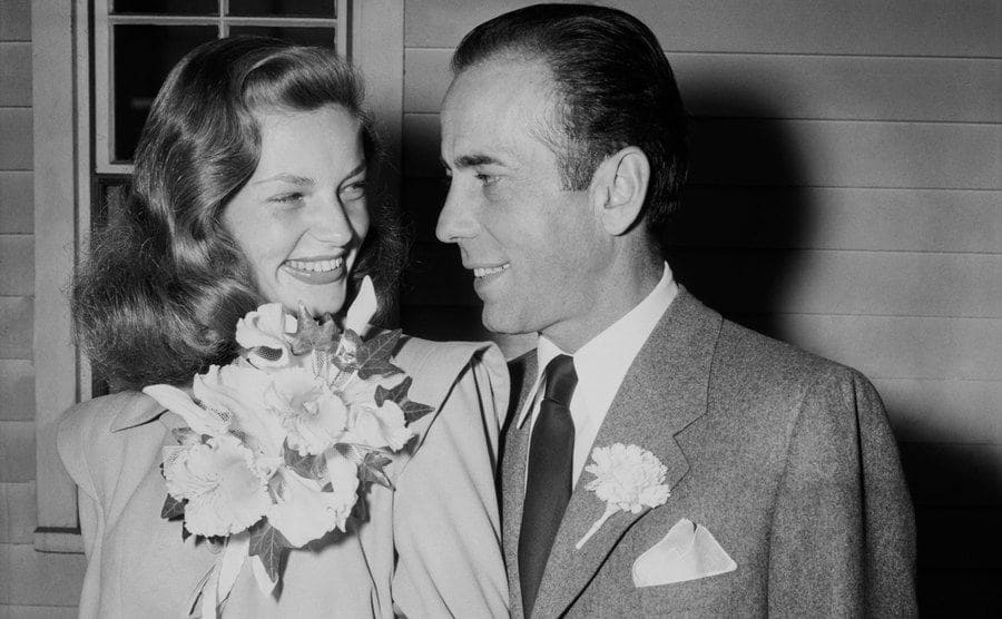 Bacall smiles at her new husband, Bogart.