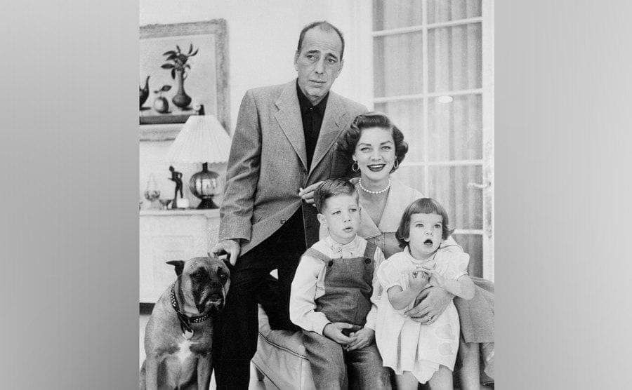 The Humphrey Bogart family is sitting in the living room.