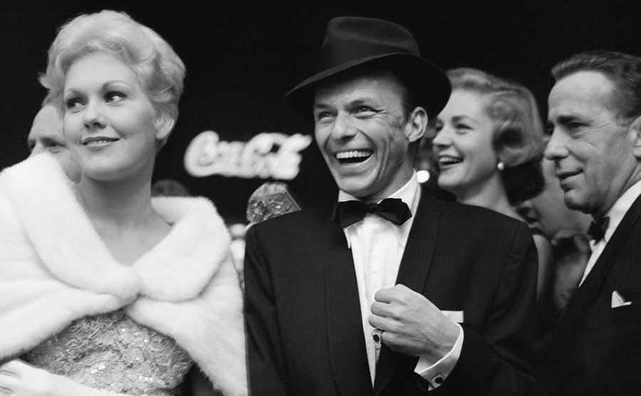 Kim Novack, Frank Sinatra, Lauren Bacall, and Humphrey Bogart at a party.