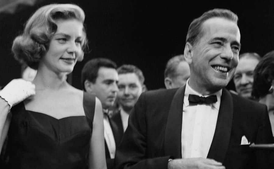 Lauren Bacall and Humphrey Bogart are attending an event.
