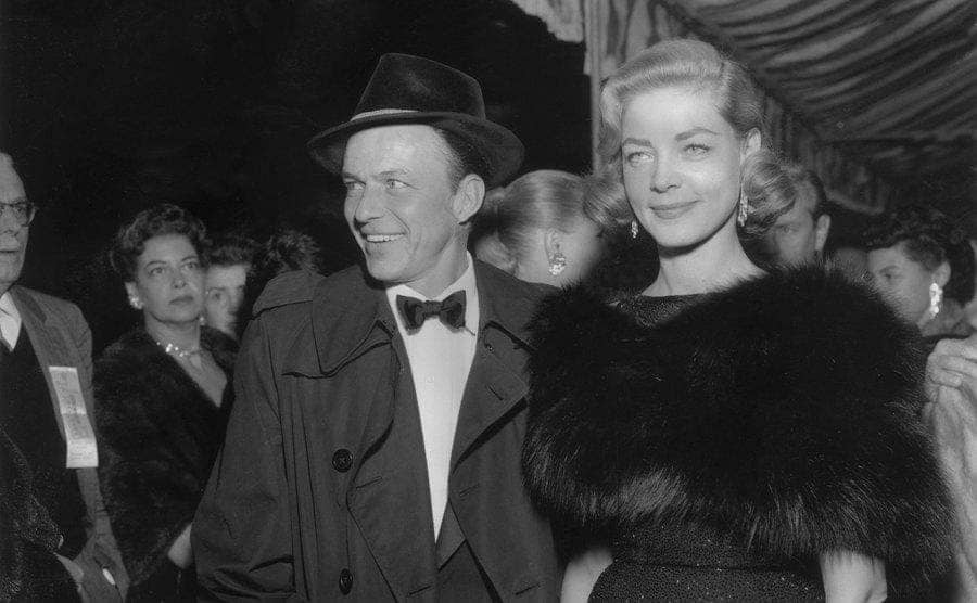 Frank Sinatra and Lauren Bacall attend a formal event.