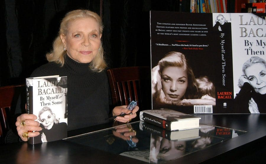 Lauren Bacall poses with her book.