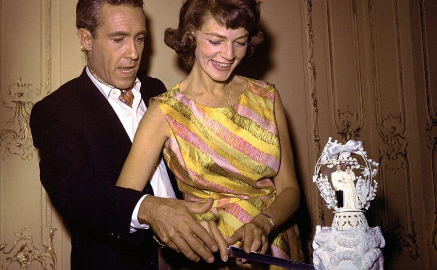 Jason Robards Jr. and Lauren Bacall cut their wedding cake.