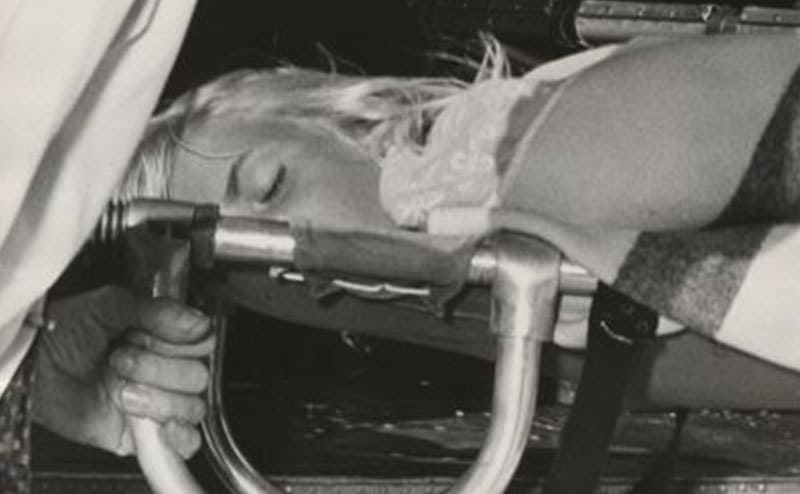 A close-up on Terry Jo as Coast Guards take her to the hospital.