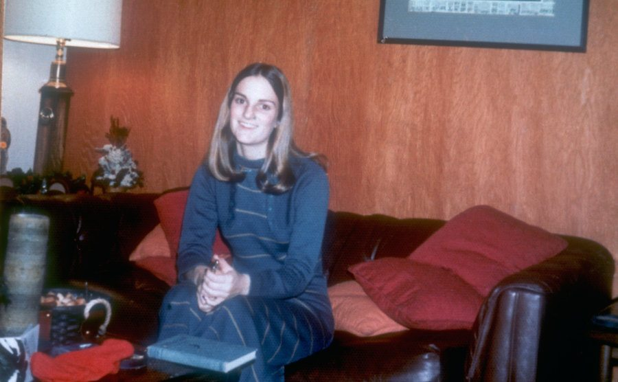 A photograph of Patty in her house.