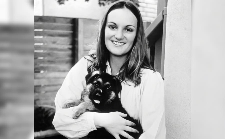 A portrait of Patty Hearst at home.