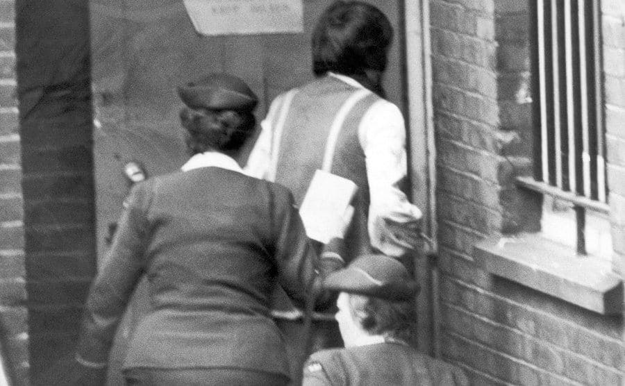 Myra Hindley with two officers in prison.