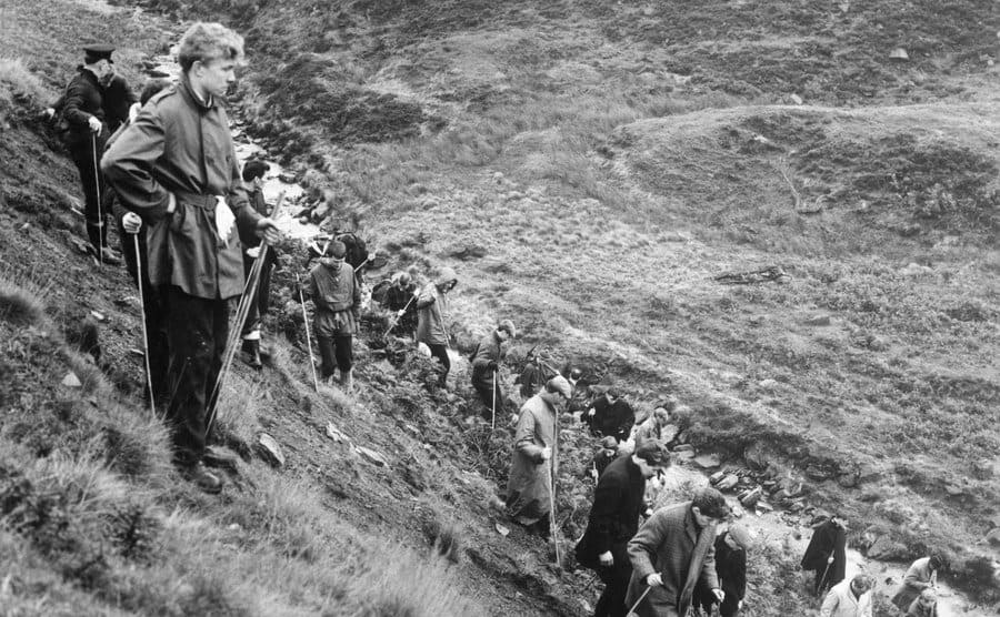 Searchers scour the moors looking for the victims' bodies.