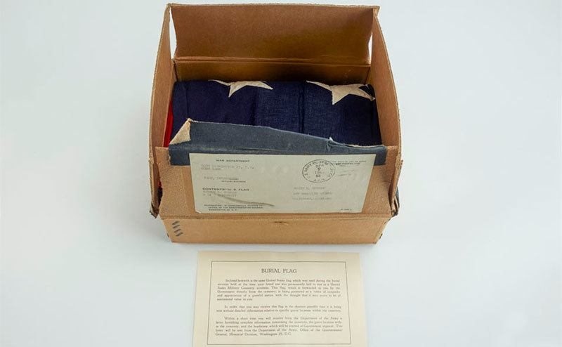 A box contains the Burial flag sent to Vernon's wife.
