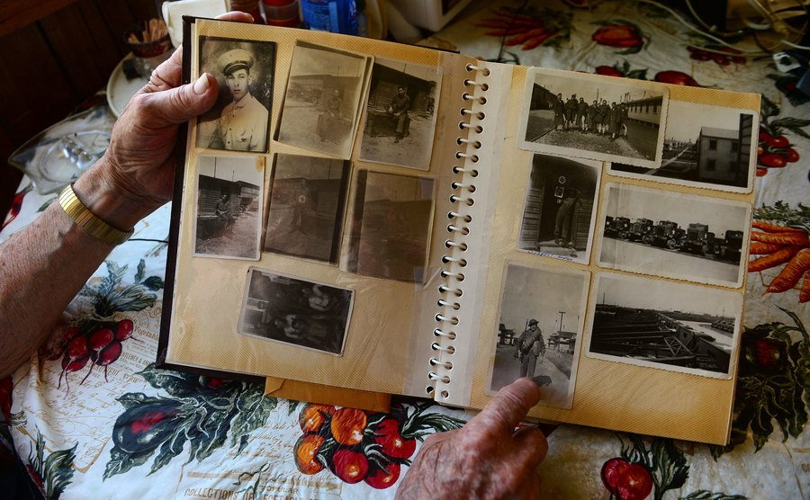 A veteran looks over old photographs at his home.