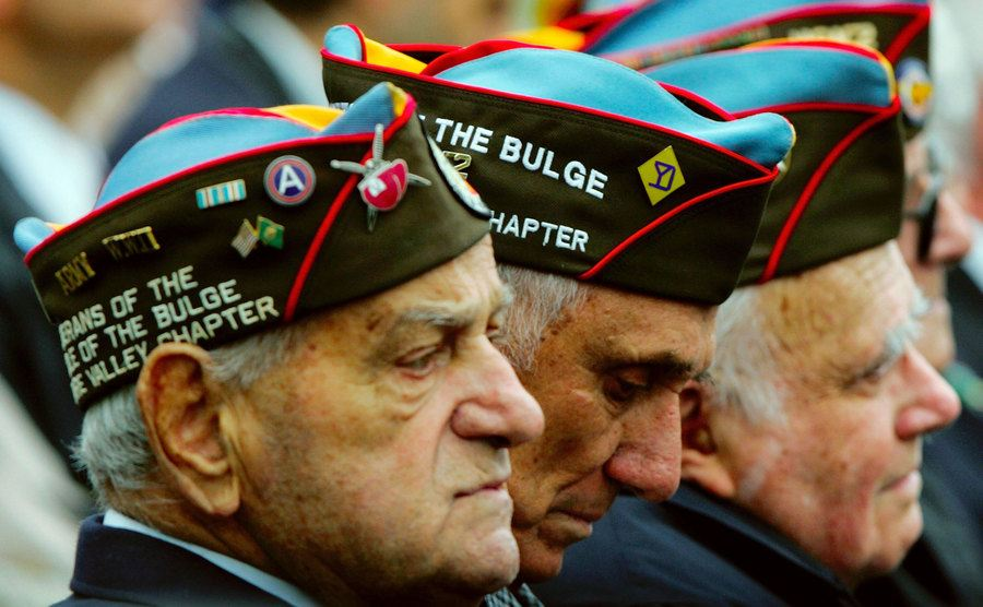 WWII veterans attend a dedication ceremony.