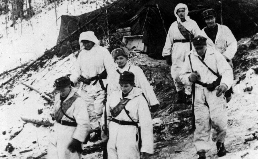 A German patrol is wearing white camouflage.