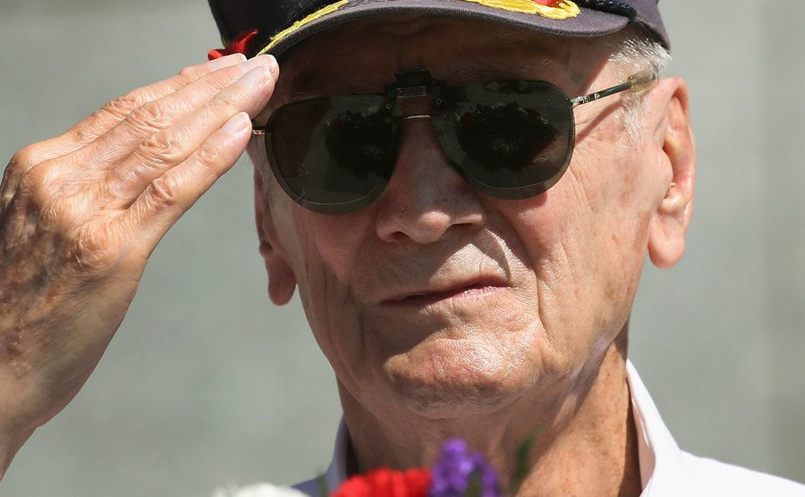 A war veteran attends an anniversary ceremony.
