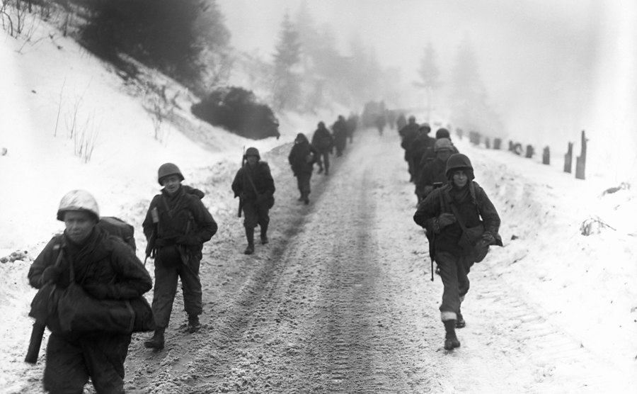 Troops march through the snow.