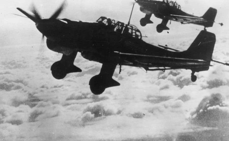 German Junkers are flying above the clouds.