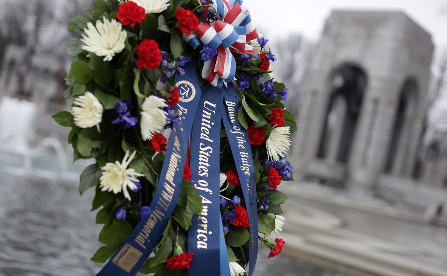 A wreath is laid during a war commemoration event.