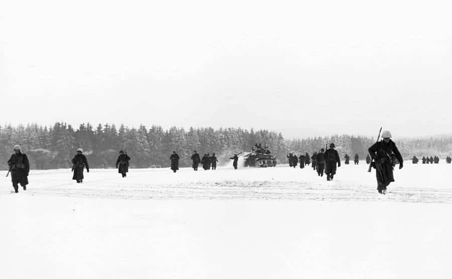 American troops advance through the snowfield.