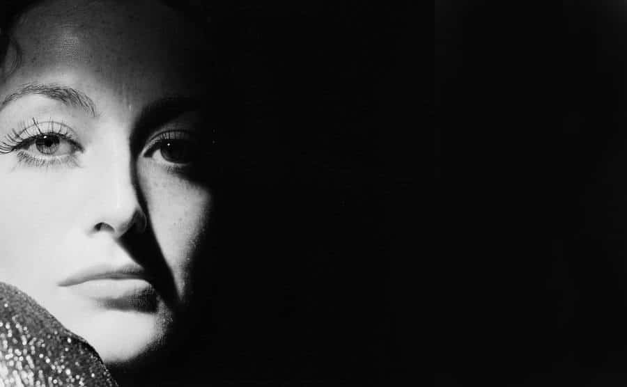 A picture of Joan Crawford in the shadows.