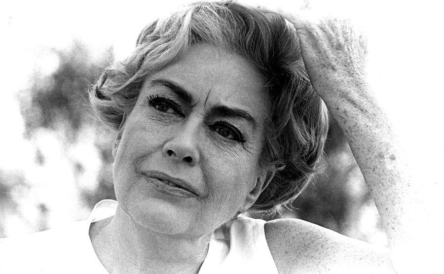 A portrait of an older Joan Crawford.