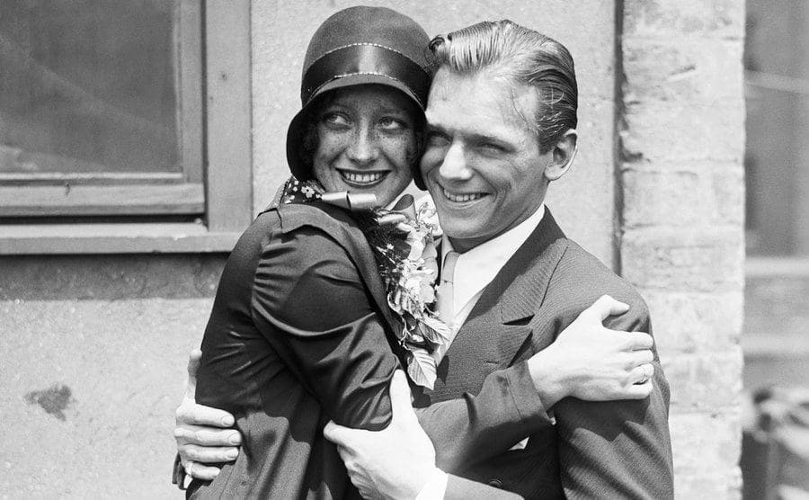 Crawford and Fairbanks embrace after the wedding.